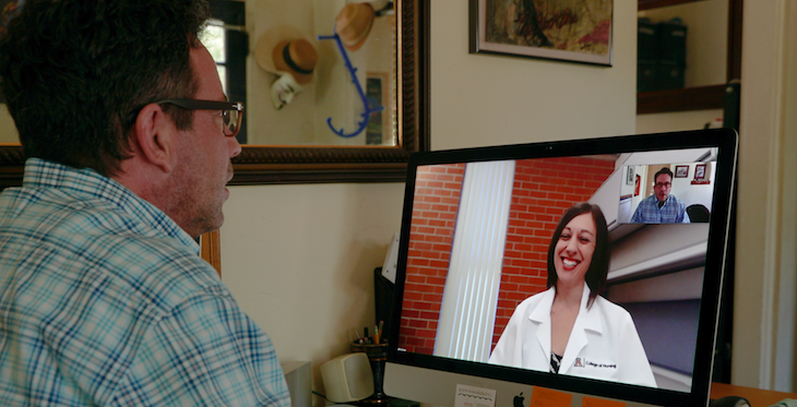 Simulation actor Brendan Guy Murphy and UA College of Nursing faculty member Sheri Carson participate in a telehealth simulation